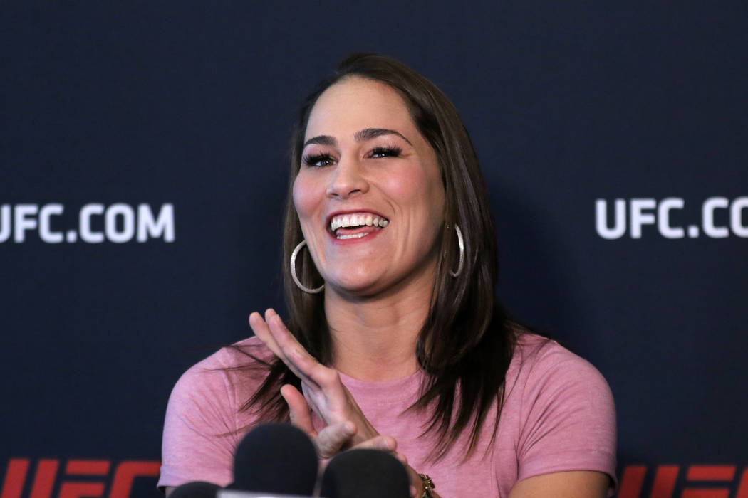 UFC flyweight contender Jessica Eye laughs as she answers a question at a media event at the UF ...