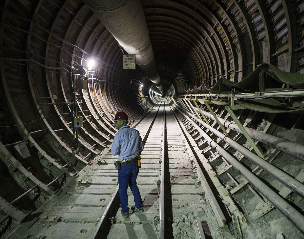 U.S. Rep. Greg Walden, R-Ore., walks through a tunnel extending from the south portal during a ...