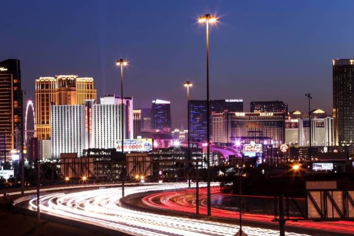 The Las Vegas Strip is lit up as traffic passes along Interstate 15. (Las Vegas Review-Journal)
