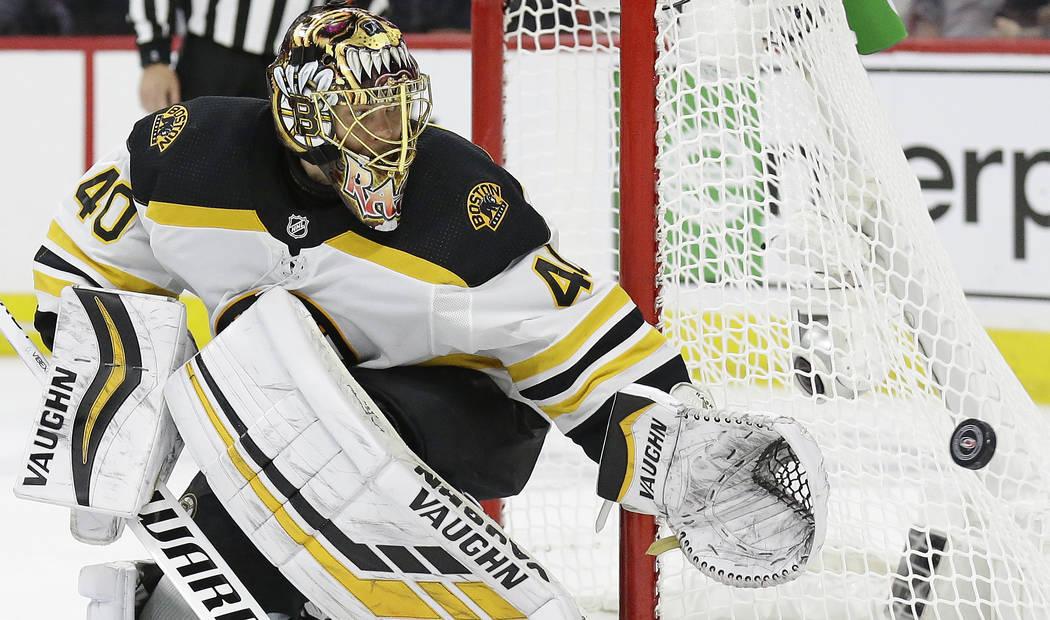 Boston Bruins goalie Tuukka Rask (40), of Finland, defends the goal against the Carolina Hurric ...