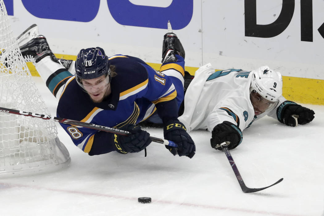 St. Louis Blues center Robert Thomas (18) falls as he chases the puck with San Jose Sharks left ...