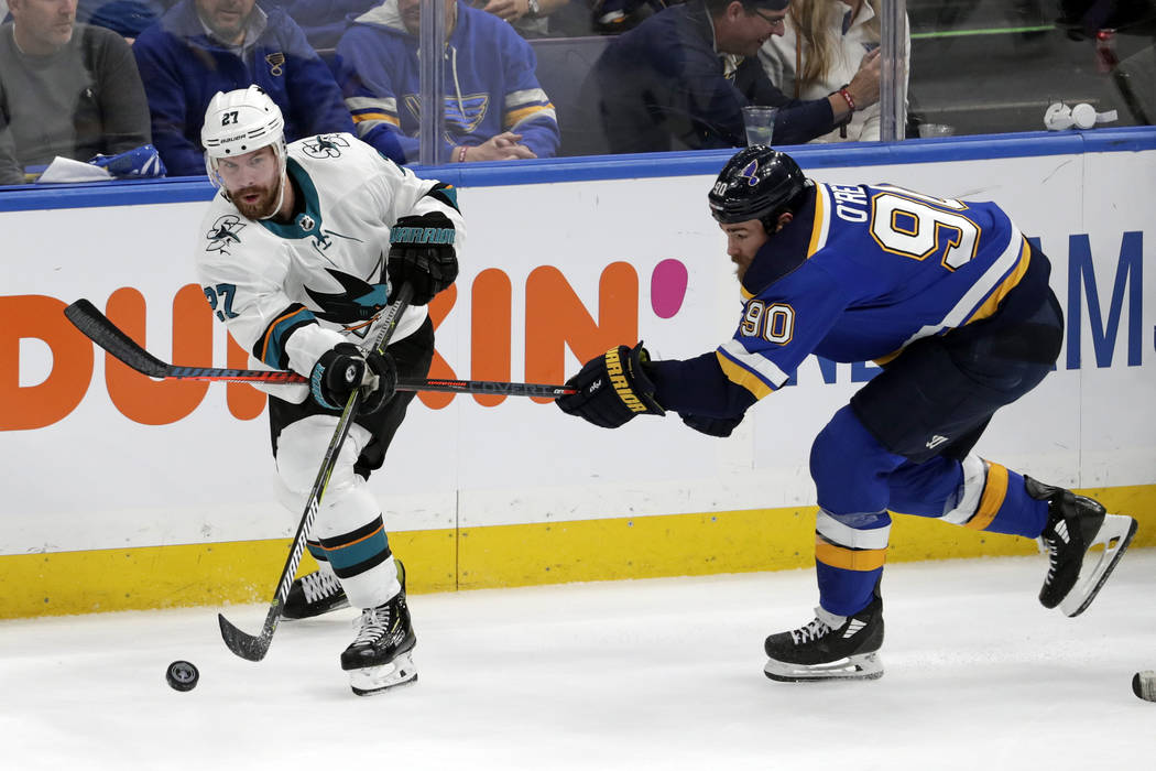 San Jose Sharks right wing Joonas Donskoi (27), of Finland, passes the puck away from St. Louis ...