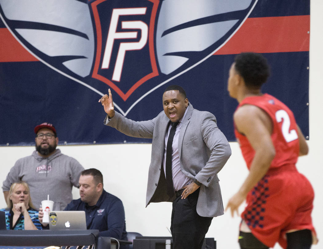 Findlay Prep head coach Rodney Haddix, middle, makes a call during the Pilot's home matchup wit ...