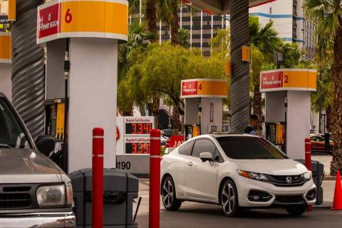 Drivers pump gas at the Shell station on E. Flamingo Road at Koval Lane in April in Las Vegas. ...