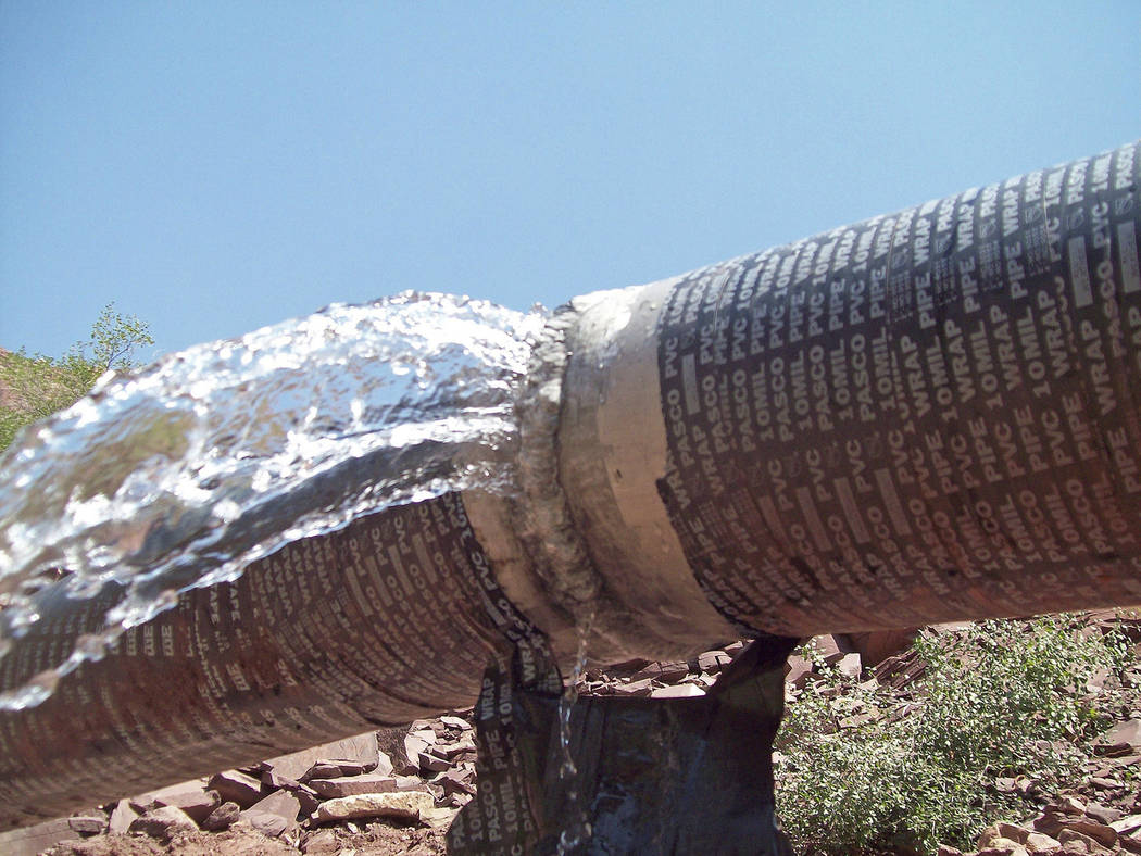 This photo shows water spraying from a break in an exposed section of the Grand Canyon trans-ca ...