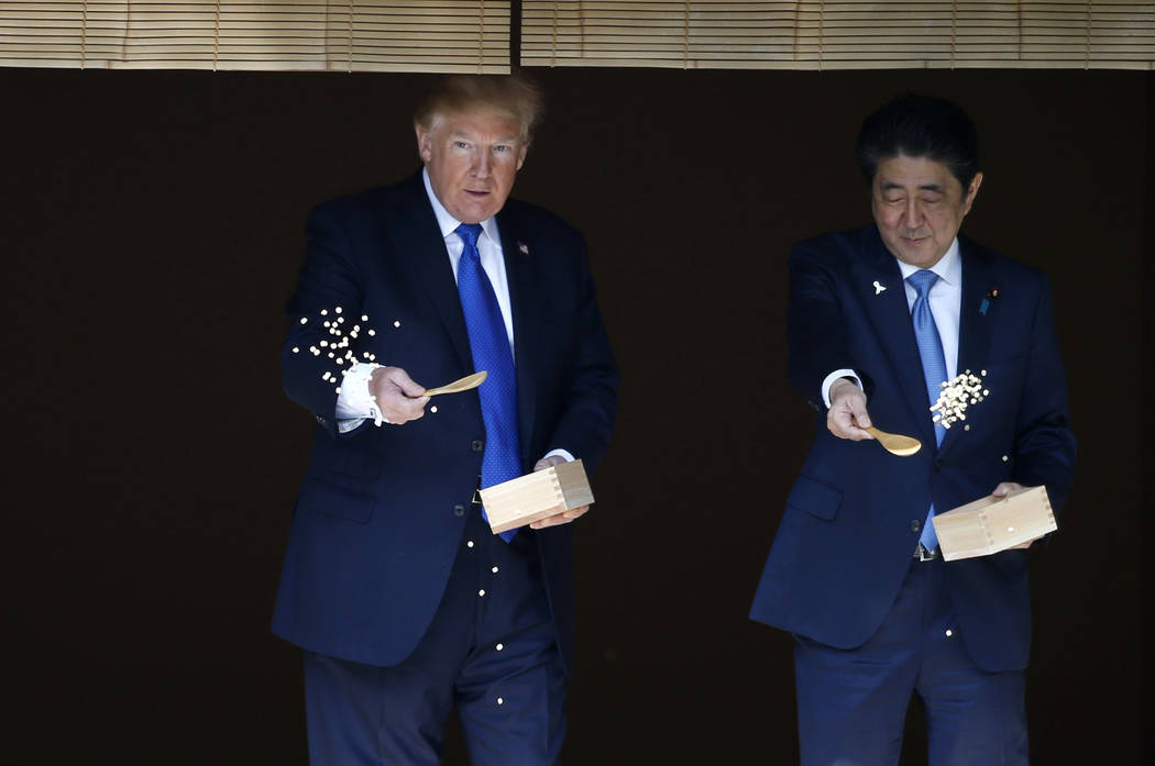 FILE - In this Nov. 6, 2017, file photo, U.S. President Donald Trump, left, and Japanese Prime ...