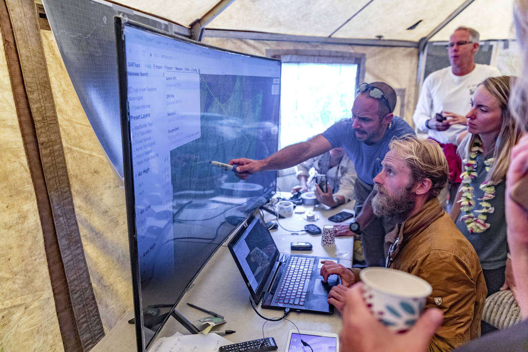 Rescue leads Javier Cantellops, top, and Chris Berquist show some of the technology used for th ...