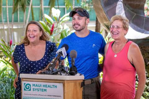 From left, Sarah Haynes, rescue lead Javier Cantellops, and Julia Eller, mother of Amanda Eller ...