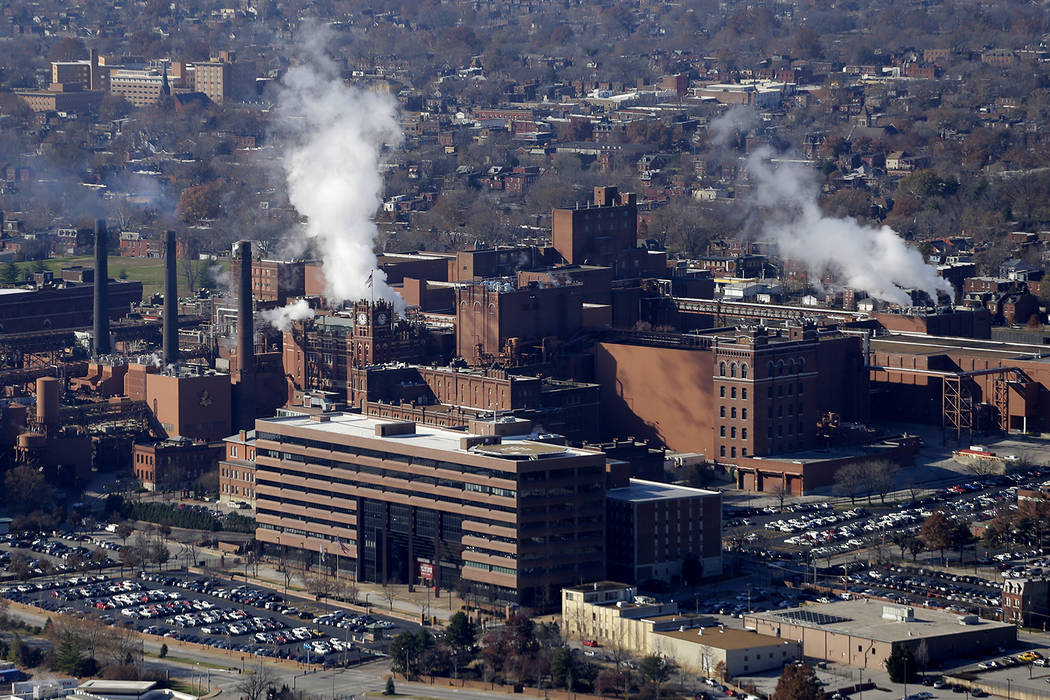 In this Tuesday, Nov. 25, 2014 file aerial photo, the Anheuser-Busch brewing complex is seen in ...