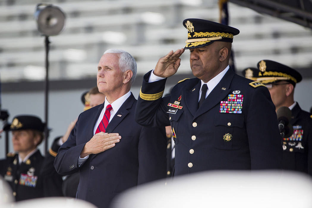 Vice President Mike Pence stands for the national anthem during graduation ceremonies at the Un ...