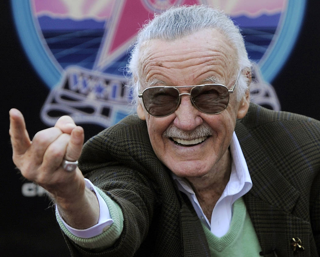 In this Jan. 4, 2011 file photo, Comic book creator Stan Lee strikes the Spiderman pose as he p ...