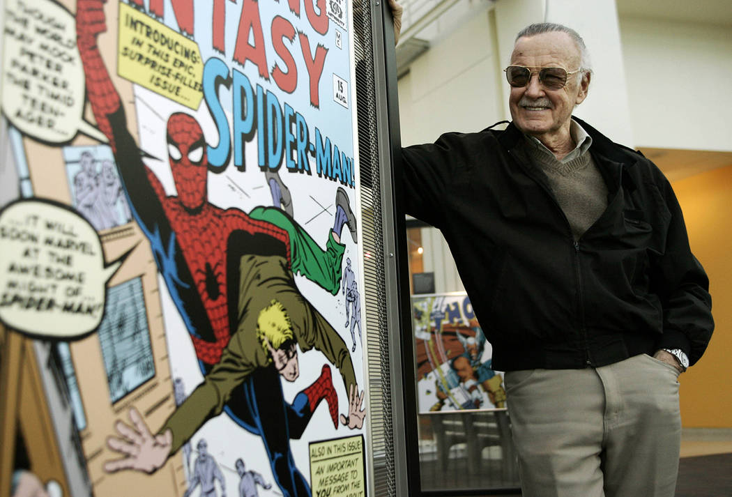 In this March 21, 2006 file photo, comic book creator Stan Lee stands beside some of his drawin ...