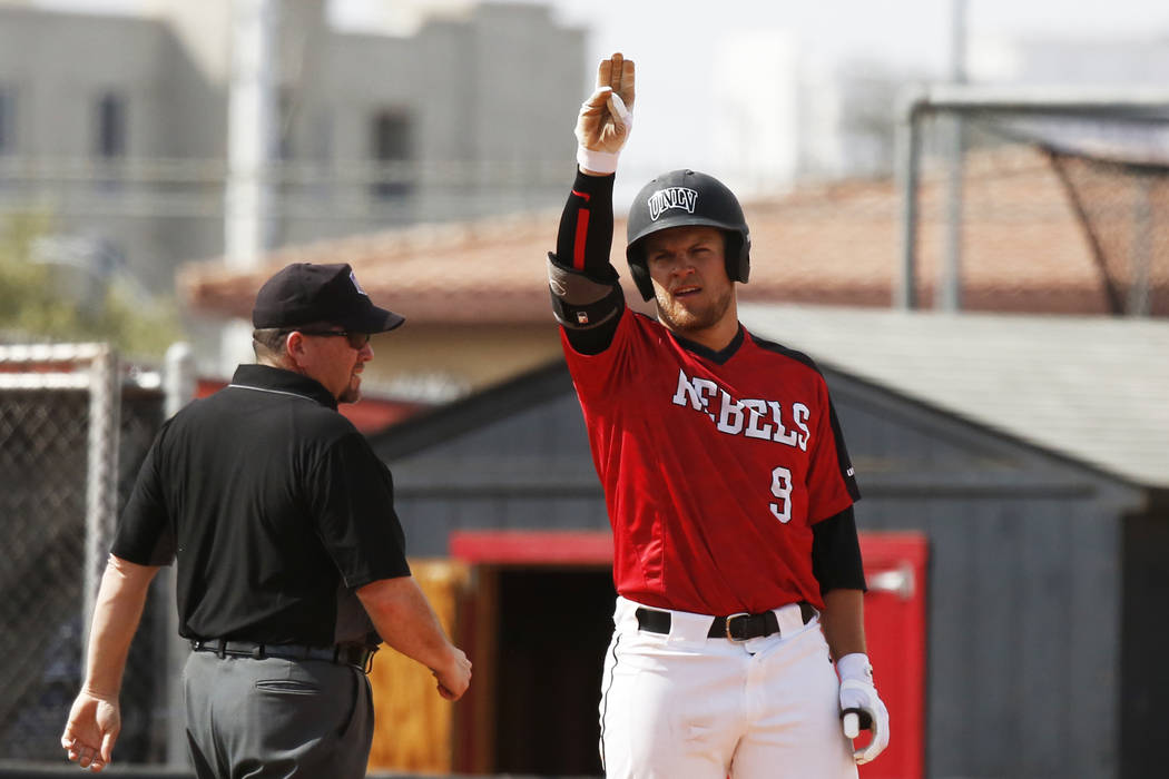 UNLV'S outfielder Max Smith (9) signals to his team after hitting a triple against Air Force at ...