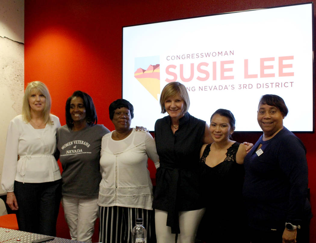 Rep.Susie Lee, D-Nev., center, poses for a photo with women veterans, from left to right, Air F ...