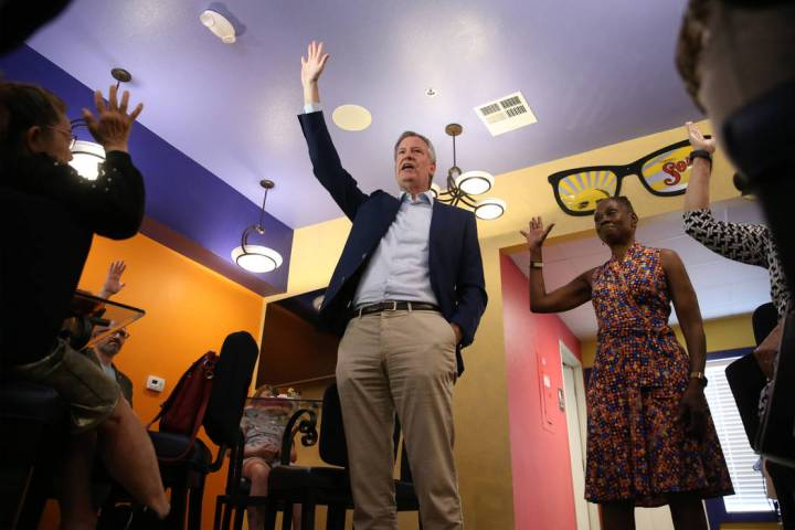 New York Mayor Bill de Blasio, center, a Democratic presidential candidate, with his wife Chirl ...
