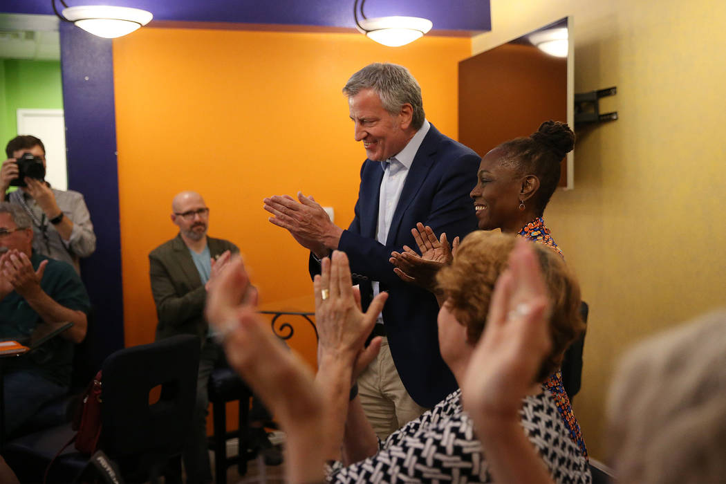 New York Mayor Bill de Blasio, left, a Democratic presidential candidate, with his wife Chirlan ...