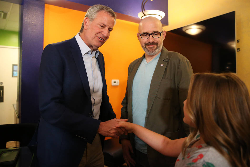New York Mayor Bill de Blasio, from left, a Democratic presidential candidate, meets Brian Shep ...