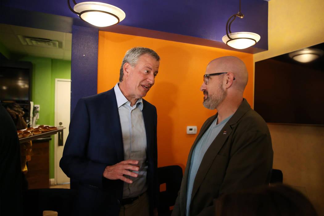 New York Mayor Bill de Blasio, left, a Democratic presidential candidate, meets Brian Shepherd, ...