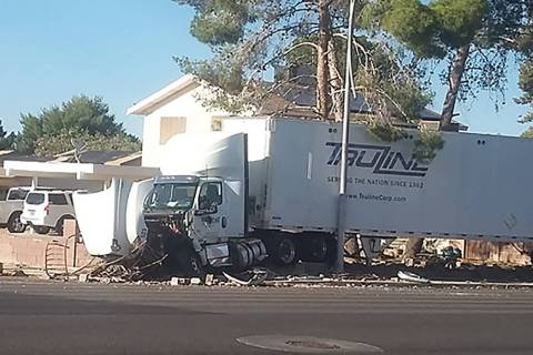 A semi-truck crashed into a residential brick wall on Windmill Lane at Wishing Well Road in Las ...
