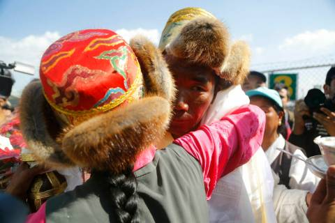 Nepalese veteran Sherpa guide Kami Rita, 49, is welcomed by his sister at the airport in Kathma ...