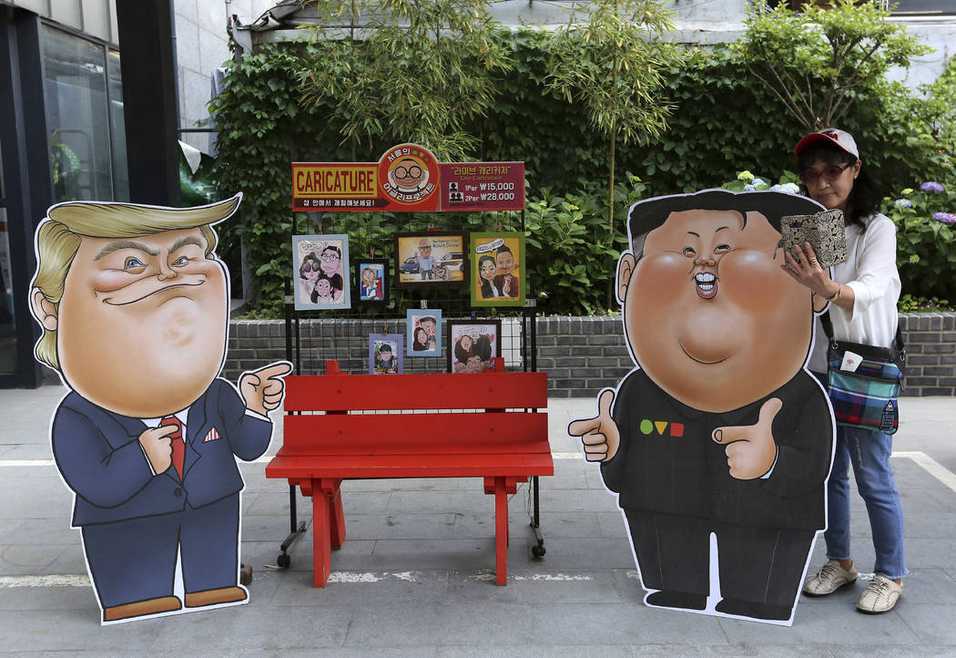 Caricatures depicting U.S. President Donald Trump, left, and North Korean leader Kim Jong Un ar ...