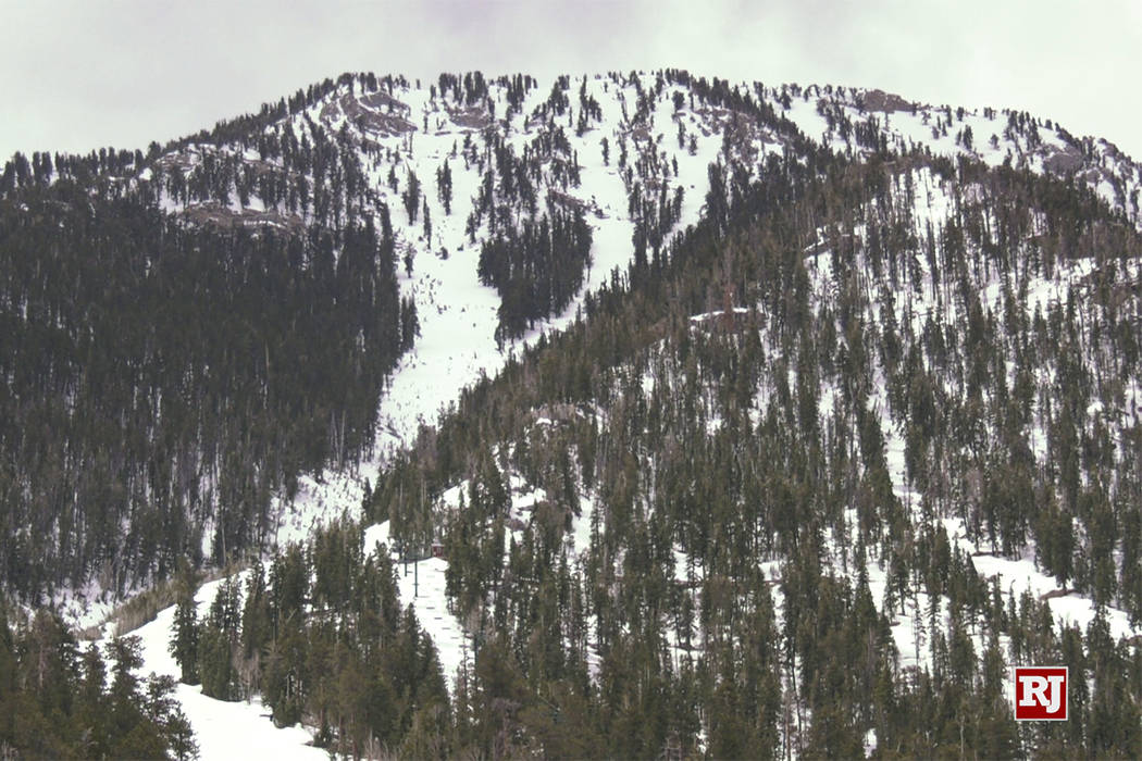 The eaks of Mount Charleston and Lee Canyon Ski area are covered in early morning snow Sunday, ...