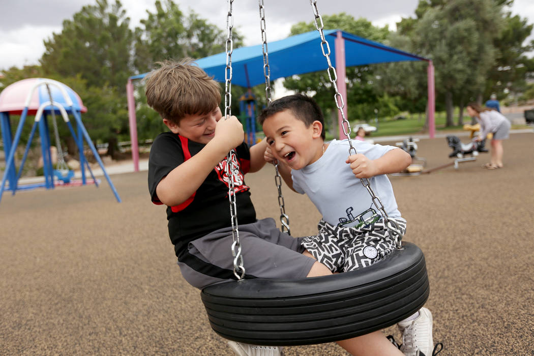 Eli Reyes, 10, left, plays with his brother Alec Reyes, 5, at Bicentennial Park in Boulder City ...