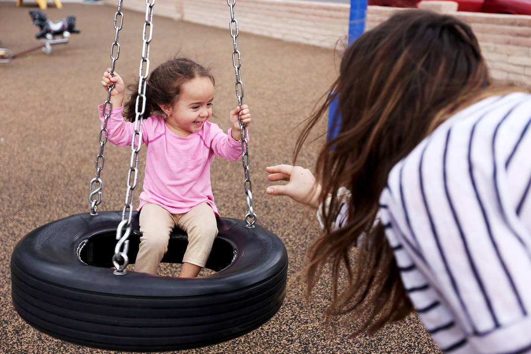 Michelle Reyes plays with her daughter Yhani Reyes, 2, at Bicentennial Park in Boulder City, Su ...