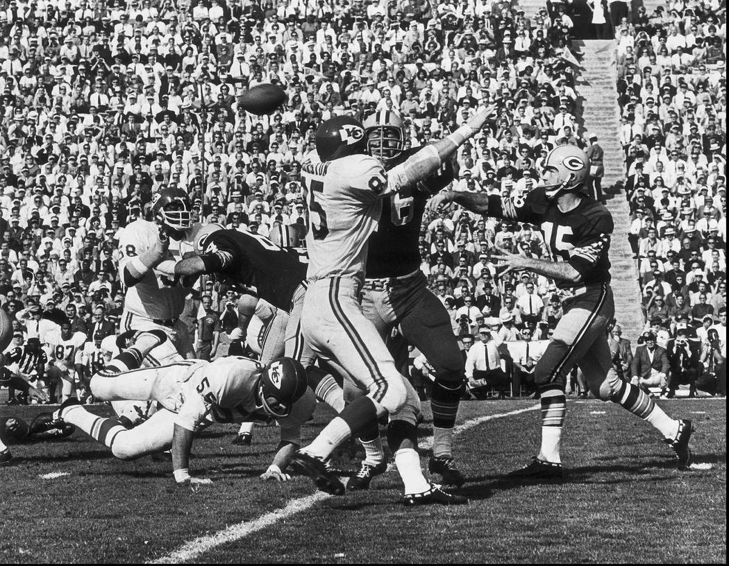 FILE - In this Jan. 16, 1967, file photo, Green Bay Packers quarterback Bart Starr, right, thro ...