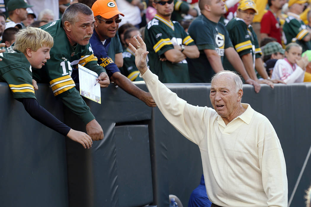 FILE - In this Sept. 10, 2012, file photo, former Green Bay Packers quarterback Bart Starr wave ...