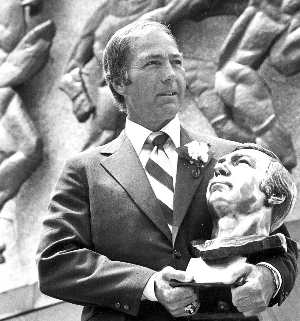 FILE - In this July 30, 1977, file photo, Bart Starr poses with his bust after his induction in ...