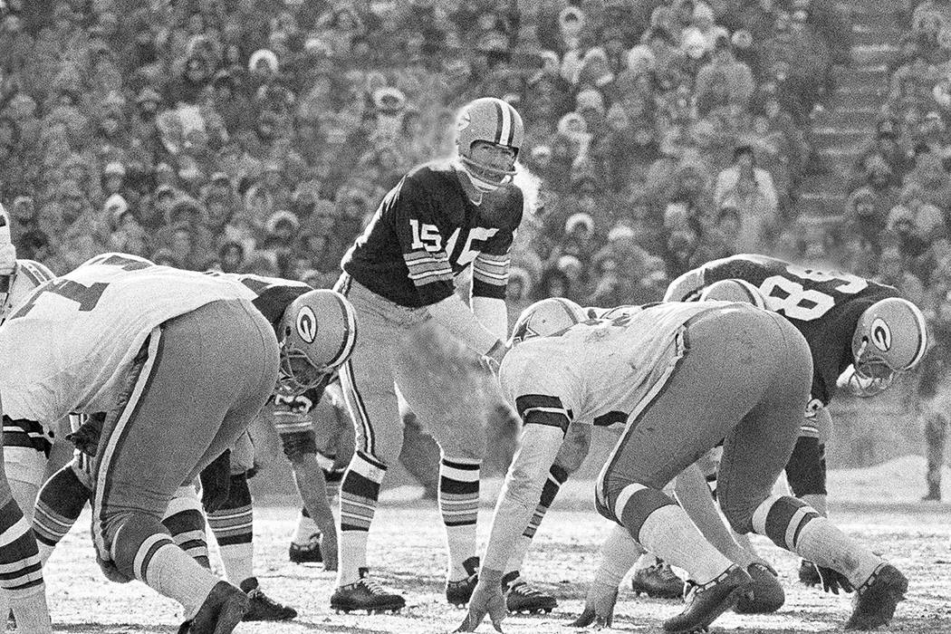 FILE - In this Dec. 31, 1967, file photo, Green Bay Packers quarterback Bart Starr calls signal ...