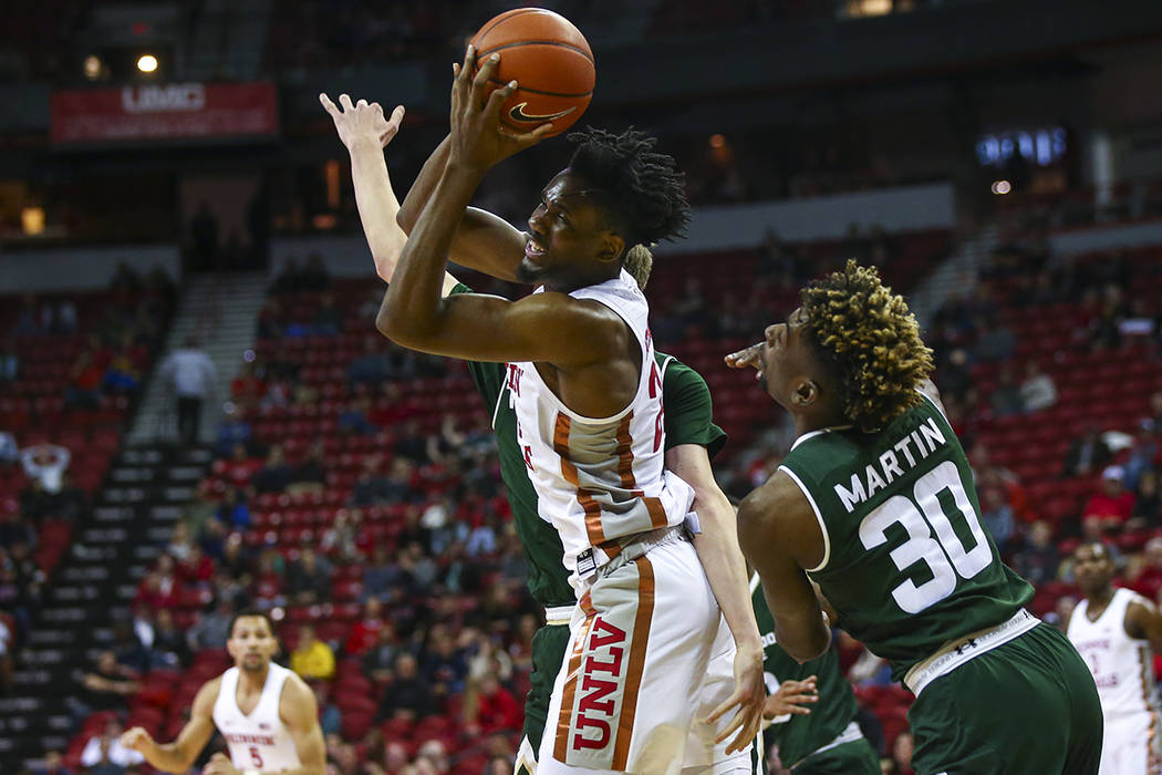 UNLV Rebels forward Joel Ntambwe (24) gets a rebound in front of Colorado State guard Kris Mart ...