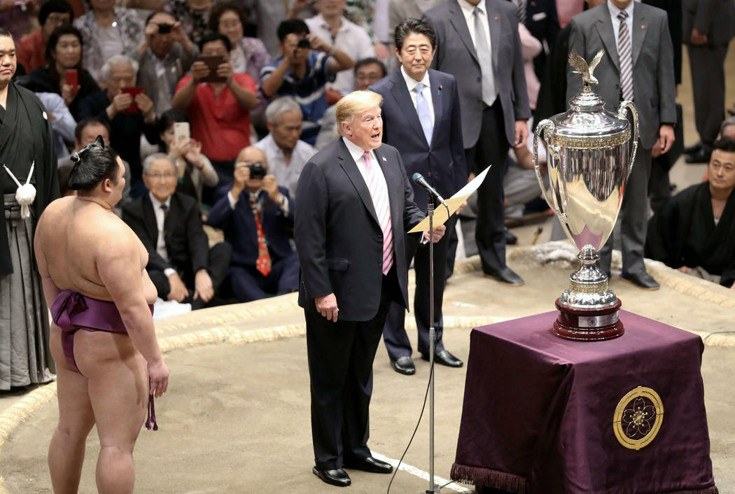 """President Donald Trump, center, speaks as Trump presents the """"President's Cup"""" trophy ..."""