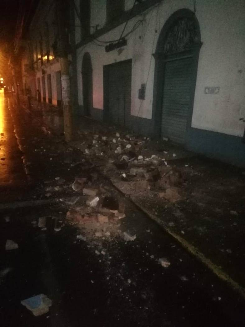 In this photo provided by Firefighters of Peru, debris covers a street after an earthquake in Y ...