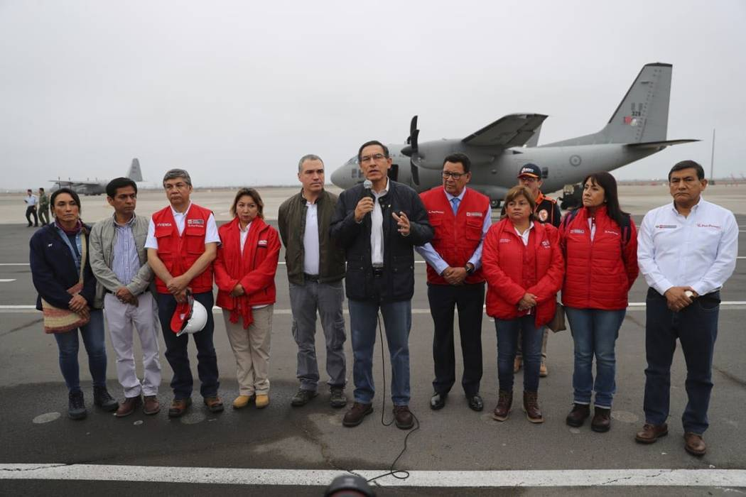 In this photo provided by the Government Palace Press Office, Peru's President Martin Vizcarra, ...