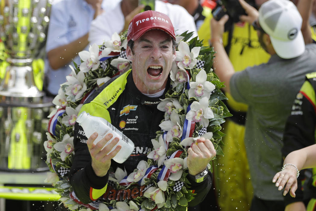 Simon Pagenaud, of France, celebrates after winning the Indianapolis 500 IndyCar auto race at I ...