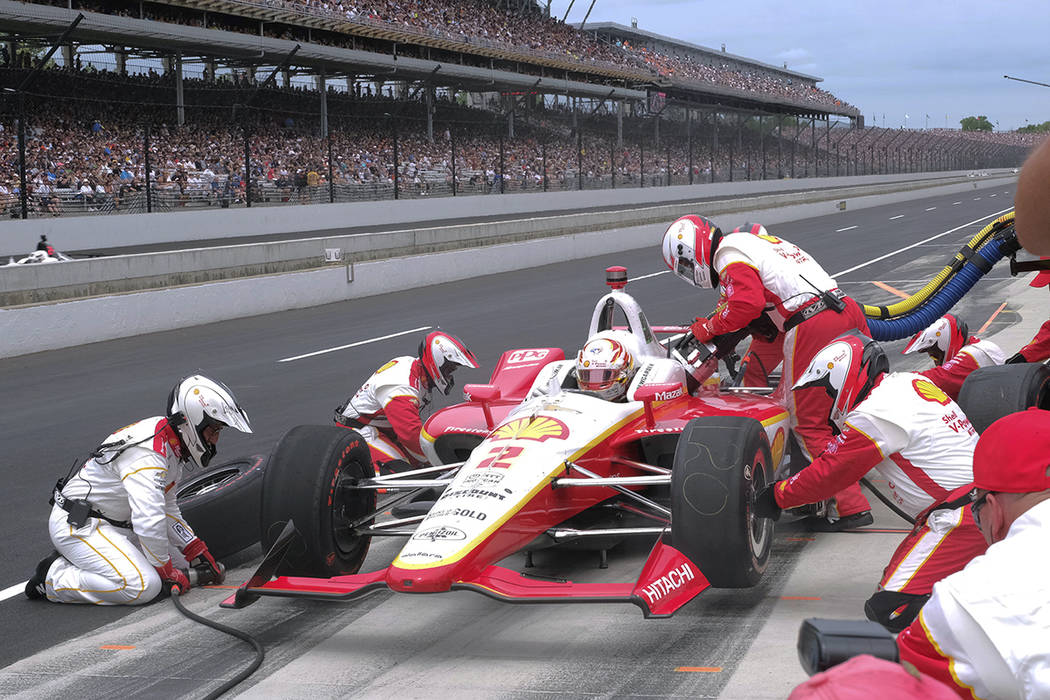Josef Newgarden makes his first pit stop during the Indianapolis 500 IndyCar auto race at India ...