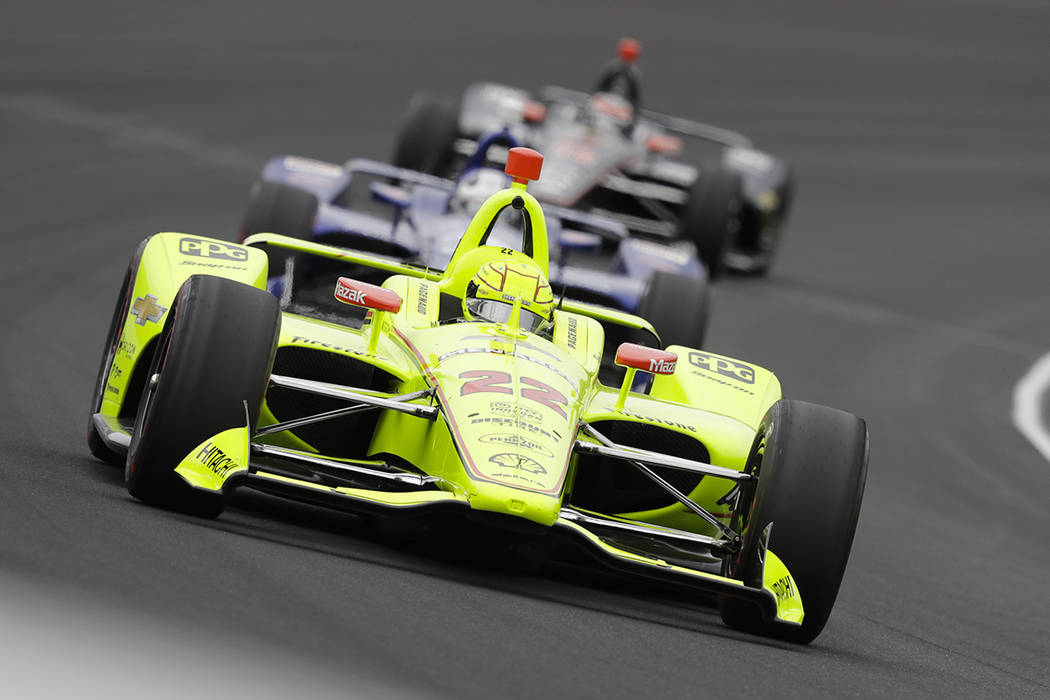 Simon Pagenaud, of France, leads a pack through the first turn during the Indianapolis 500 Indy ...