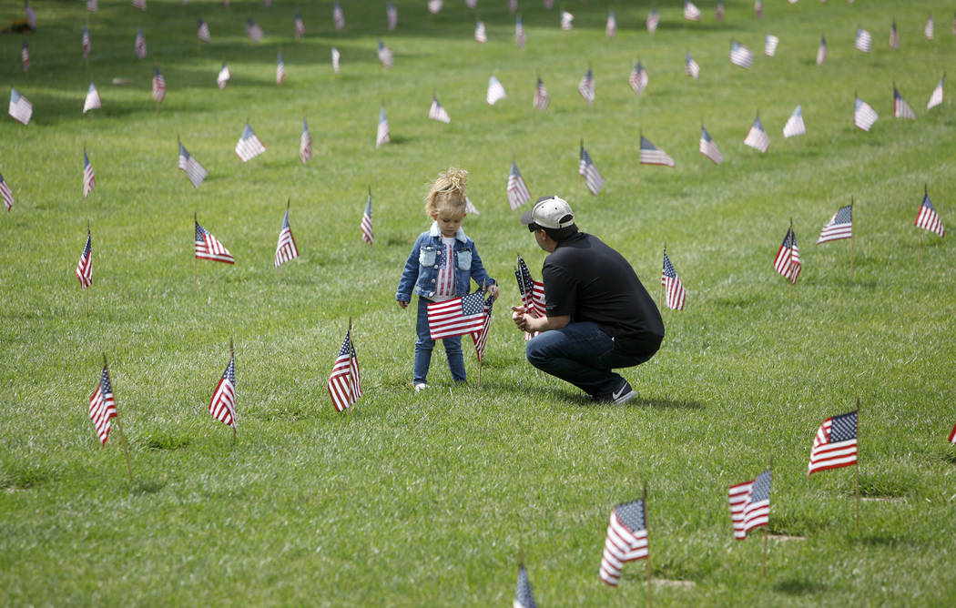 Liyah Makarechian, 3, sits with her dad Paul Makarechian at the Southern Nevada Veterans Memori ...