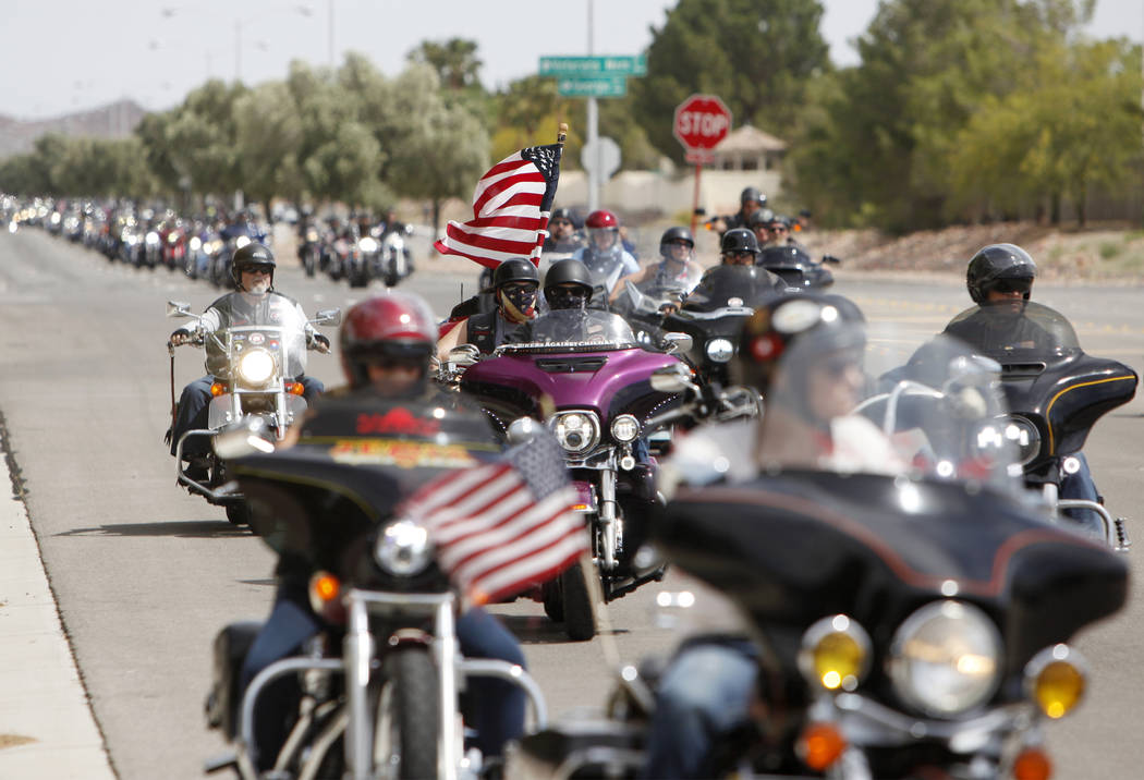 Hundreds of motorcyclists pull up to the Southern Nevada Veterans Memorial Cemetery for a cerem ...