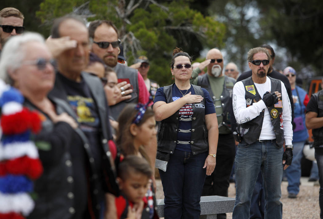 The crowd pledges allegiance to the flag during a ceremony to honor those who have died while s ...
