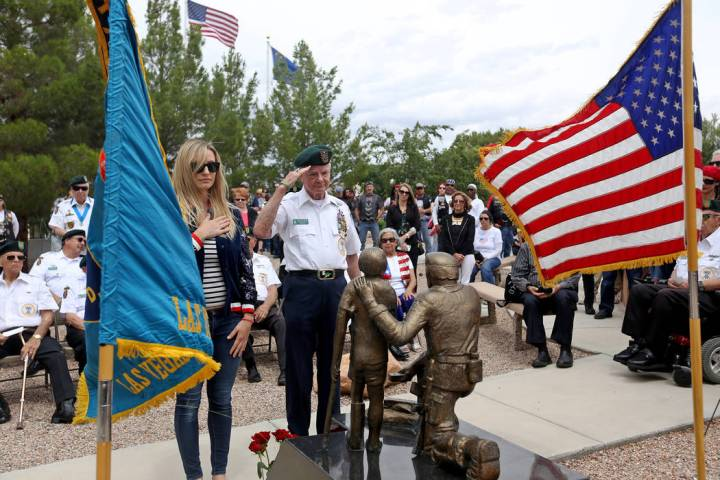 Ed Davis, a members of the Special Forces Association, salutes during a ceremony honoring speci ...