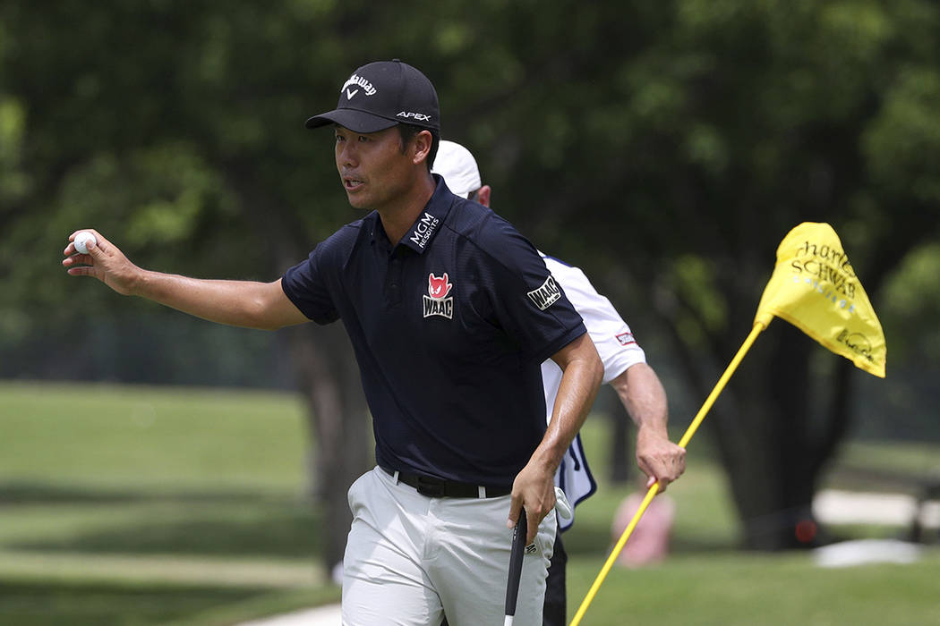Kevin Na gestures after making a birdie on the sixth green in the final round of the Charles Sc ...
