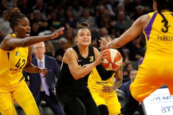 In this July 15, 2018, file photo, Las Vegas Aces guard Kayla McBride (21) looks to shoot a bas ...
