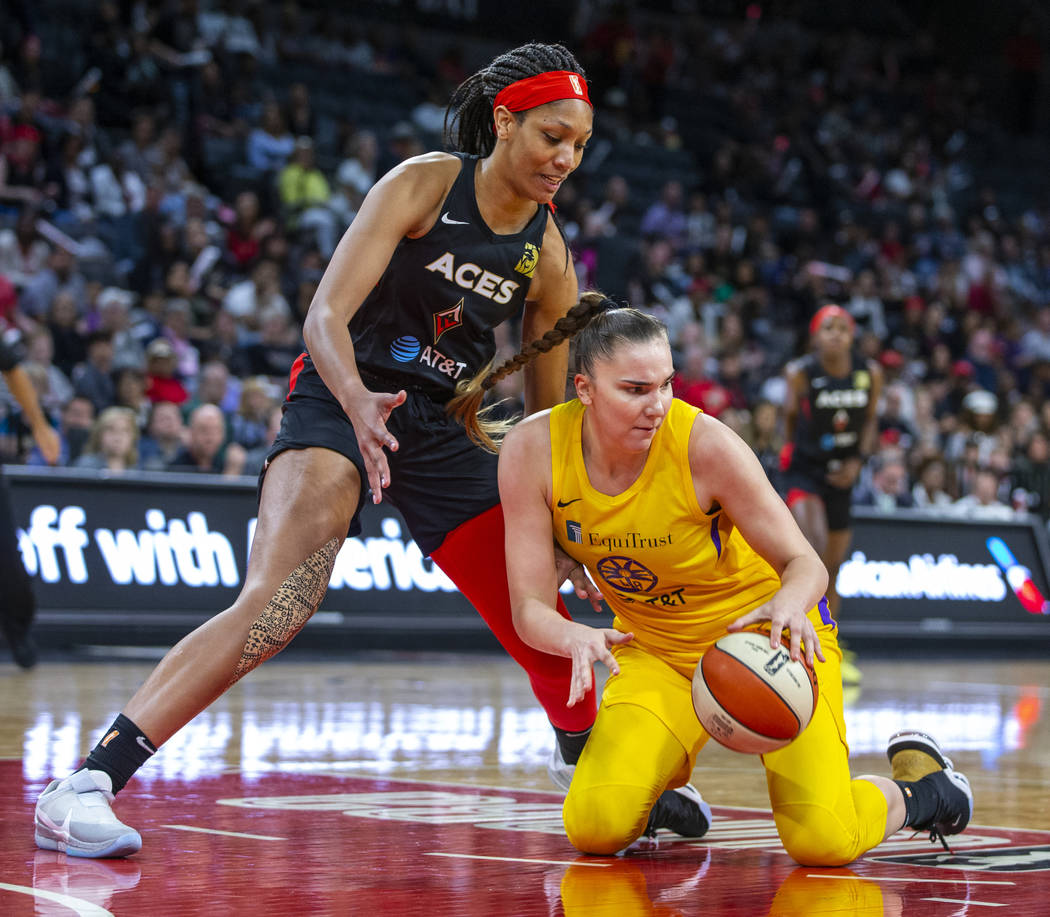 Las Vegas Aces center A'ja Wilson (22) looks down to the ball scooped up by Los Angeles Sparks ...