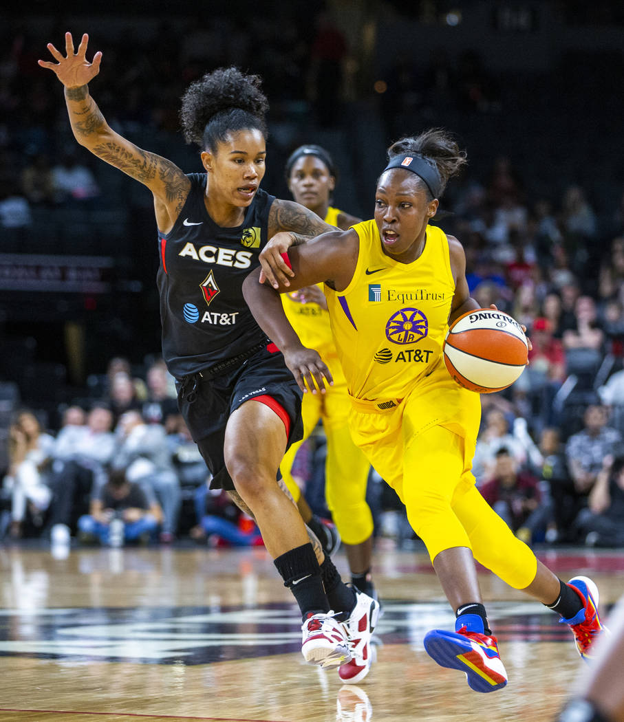 Las Vegas Aces forward Tamera Young (1) defends the lane from Los Angeles Sparks guard Chelsea ...