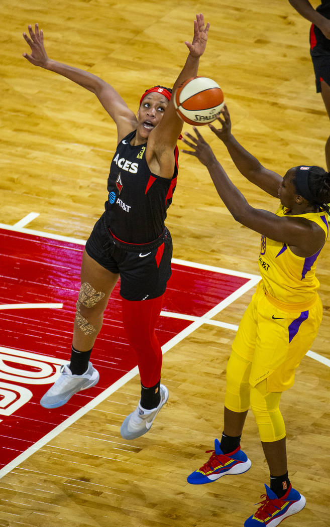 Las Vegas Aces center A'ja Wilson (22) rejects a shot by Los Angeles Sparks guard Chelsea Gray ...