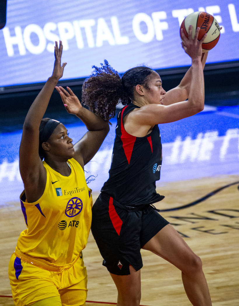 Los Angeles Sparks center Kalani Brown (21) defends the basket from Las Vegas Aces forward Dear ...