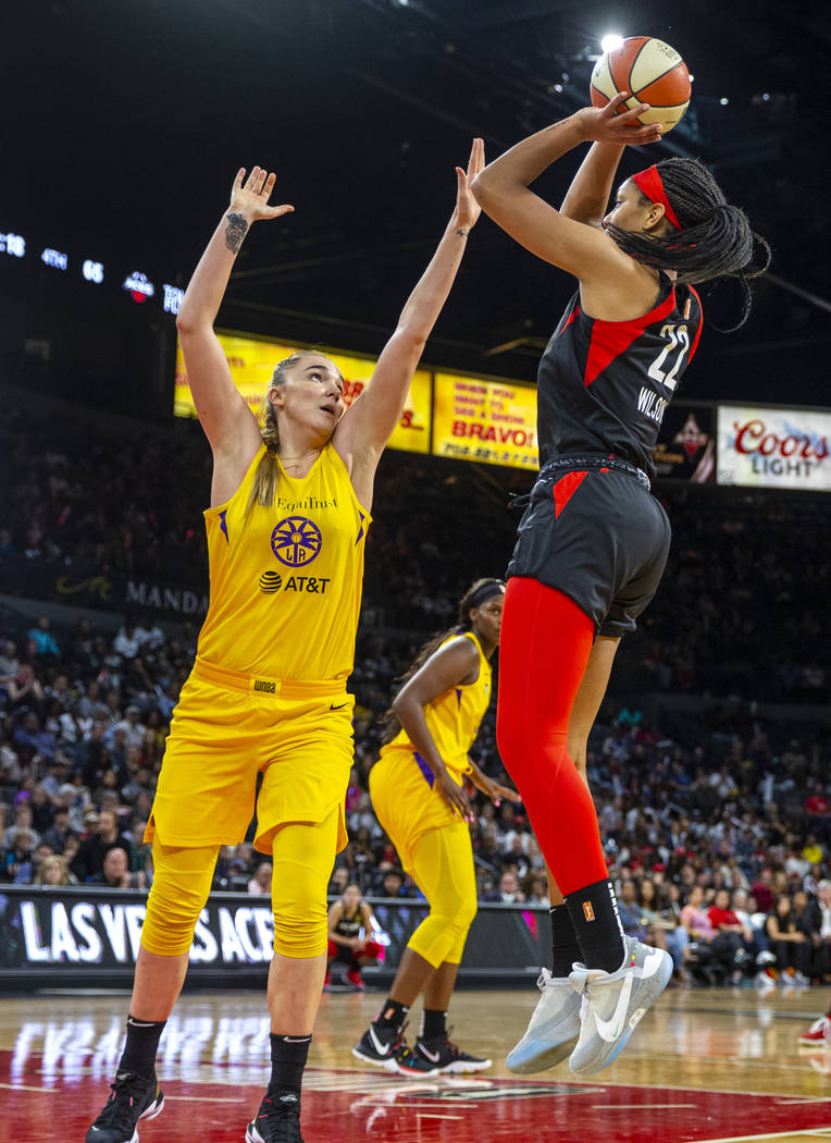 Los Angeles Sparks forward/center Maria Vadeeva (7) attempts to defend a shot by Las Vegas Aces ...